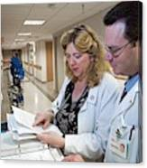 Palliative Nurse And Doctor Canvas Print
