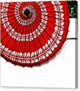 Paper Umbrella With Swirl Pattern On Fence Canvas Print