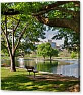 Park Bench By A Lake Canvas Print