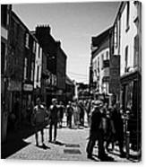 pedestrians walking down closed pedestrian area of quay street on sunny sunday afternoon Galway city Canvas Print