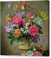 Peonies And Irises In A Ceramic Vase Canvas Print