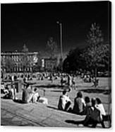 people sitting enjoying the sunshine Eyre Square in the heart of Galway city county Galway Republic of Ireland Canvas Print