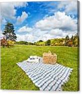 Picnic Blanket And Basket In Sunny Field Canvas Print