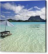 Picnic Table And Umbrella In Clear Lagoon Canvas Print
