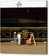 Pilot Works On Antique Plane In Hood Canvas Print