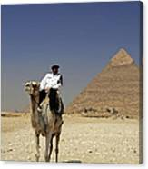 Police Officer On A Camel In Front Of Pyramid In Cairo Egypt Canvas Print
