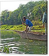 Poling A Dugout Canoe In The Rapti River In Chitwan National Park-nepal Canvas Print