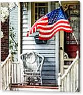 Porch With Flag And Wicker Chair Canvas Print