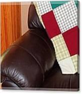 Quilt Beside A Fireplace Canvas Print