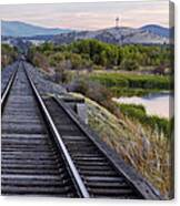 Railroad Tracks Leading To The Mountains Canvas Print