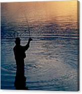 Rear View Of Fly-fisherman Silhouetted Canvas Print