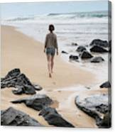 Rear View Of Woman Walking On Beach Canvas Print