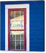 Red And White Window In Blue Wall Canvas Print