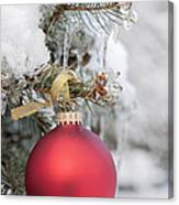 Red Christmas Ornament On Snowy Tree Canvas Print