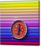 Red Compass On Rolls Of Colored Pencils Canvas Print
