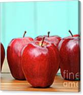Red Delicious Apples On Old School Desk Canvas Print
