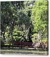 Red Footbridge Over Green Water Canvas Print