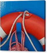 Red Life Belt On Blue Wall Canvas Print