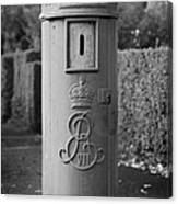 red old historic post pillar box manufactured by Handyside of Derby and London with Edward the seventh crown E Rex and VII symbols Canvas Print
