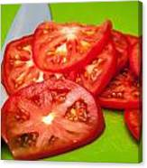 Red Tomato Slices And Knife On Green Chopping Board Canvas Print