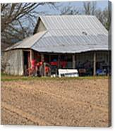 Red Tractor In A Tin Roofed Shed Canvas Print