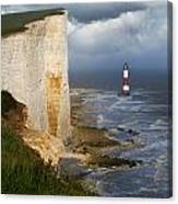 White Cliffs And Red-white Striped Lightouse In The Sea Canvas Print
