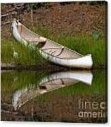 Reflecting Canoe Canvas Print