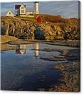 Reflecting On Nubble Lighthouse Canvas Print