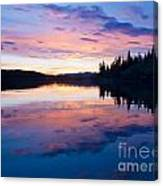 Reflection Of Sunset Sky On Calm Surface Of Pond Canvas Print