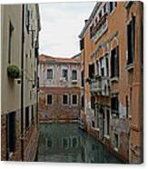 Reflections In Venetian Canal Canvas Print