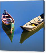 Reflections Of Two Canoes Canvas Print