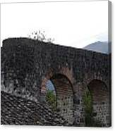 Remains Of An Old Stone Bridge Canvas Print