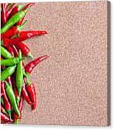 Ripe Red And Green Chillies On Cork Board Canvas Print