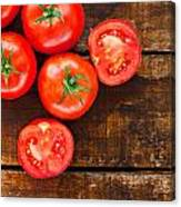Ripe Red Tomatoes On Old Wooden Table Canvas Print