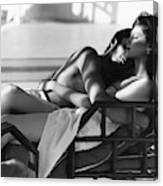 Rosie Vela Resting In A Chair With A Male Model Canvas Print