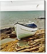 Row Boat On Rocky Shore Canvas Print