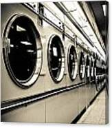 Row Of Washing Machines In Laundromat Canvas Print