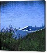 Rowboat In Grass Canvas Print