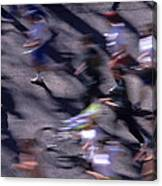 Runners Along Street In A Marathon Blurred And Abstract Canvas Print
