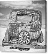 Rusty Old Car In The Snow Canvas Print