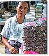 Salesman In The Marketplace In Tachilek-burma Canvas Print