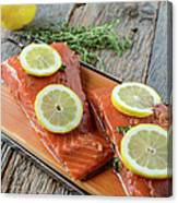 Salmon On A Cutting Board With Lemon Canvas Print
