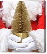 Santa Claus Holding Christmas Tree Canvas Print