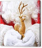 Santa Holding Reindeer Figure Canvas Print