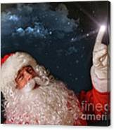 Santa Pointing With Magical Light To The Sky Canvas Print
