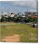 Schoolchildren Practicing On Playing Field With Singapore Skyline In Background Canvas Print