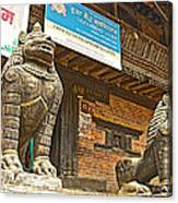 Sculptures Of Protector Figures In Front Of Sufata Buddhist College In Patan Durbar Square Canvas Print