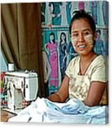 Seamstress At Her Sewing Machine In Tachilek-burma Canvas Print