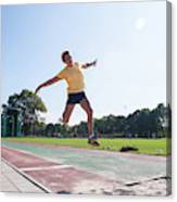 Senior Athlete (75) Practicing Long Jump Canvas Print