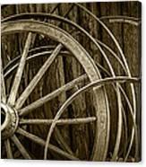 Sepia Photo Of Broken Wagon Wheel And Rims Canvas Print